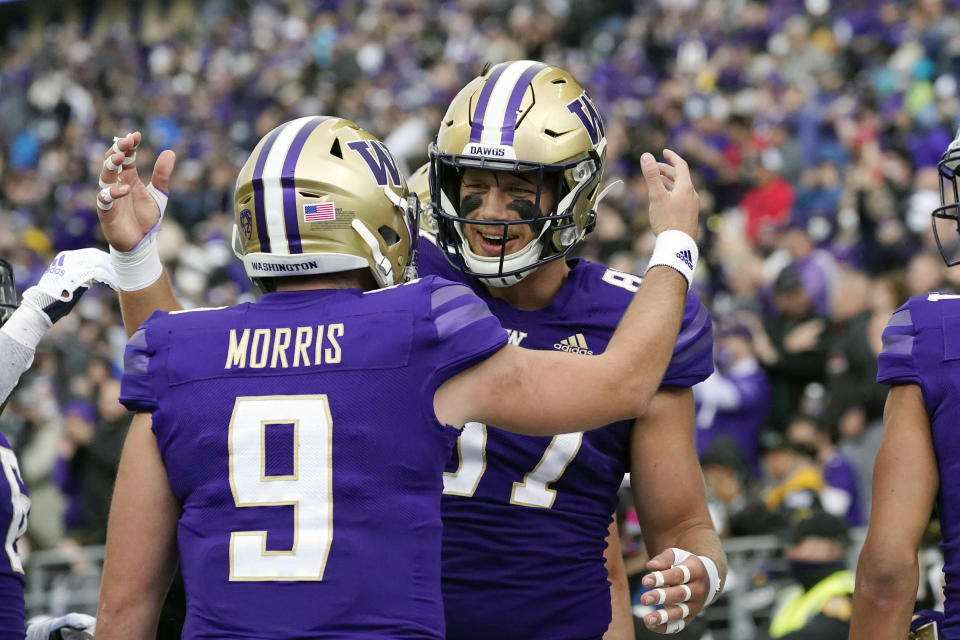 Washington tight end Cade Otton, right, celebrates his touchdown pass reception with quarterback Dylan Morris (9) in the first half of an NCAA college football game, Saturday, Sept. 18, 2021, in Seattle. (AP Photo/Elaine Thompson)