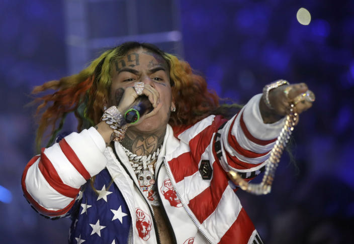 FILE- In this Sept. 21, 2018, file photo rapper Daniel Hernandez, known as Tekashi 6ix9ine, performs during the Philipp Plein women's 2019 Spring-Summer collection during the Fashion Week in Milan, Italy. U.S. District Judge Paul A. Engelmayer, who sentenced the rapper to prison said Wednesday, March 25, 2020, that he would have ordered home confinement instead, he had known about the coronavirus in December. (AP Photo/Luca Bruno, File)