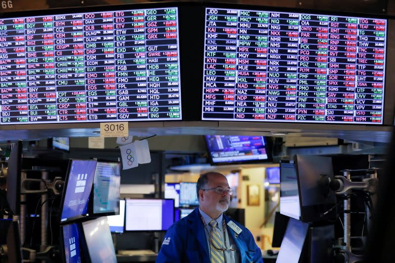 A trader works on the floor at the New York Stock Exchange (NYSE) in Manhattan, New York City