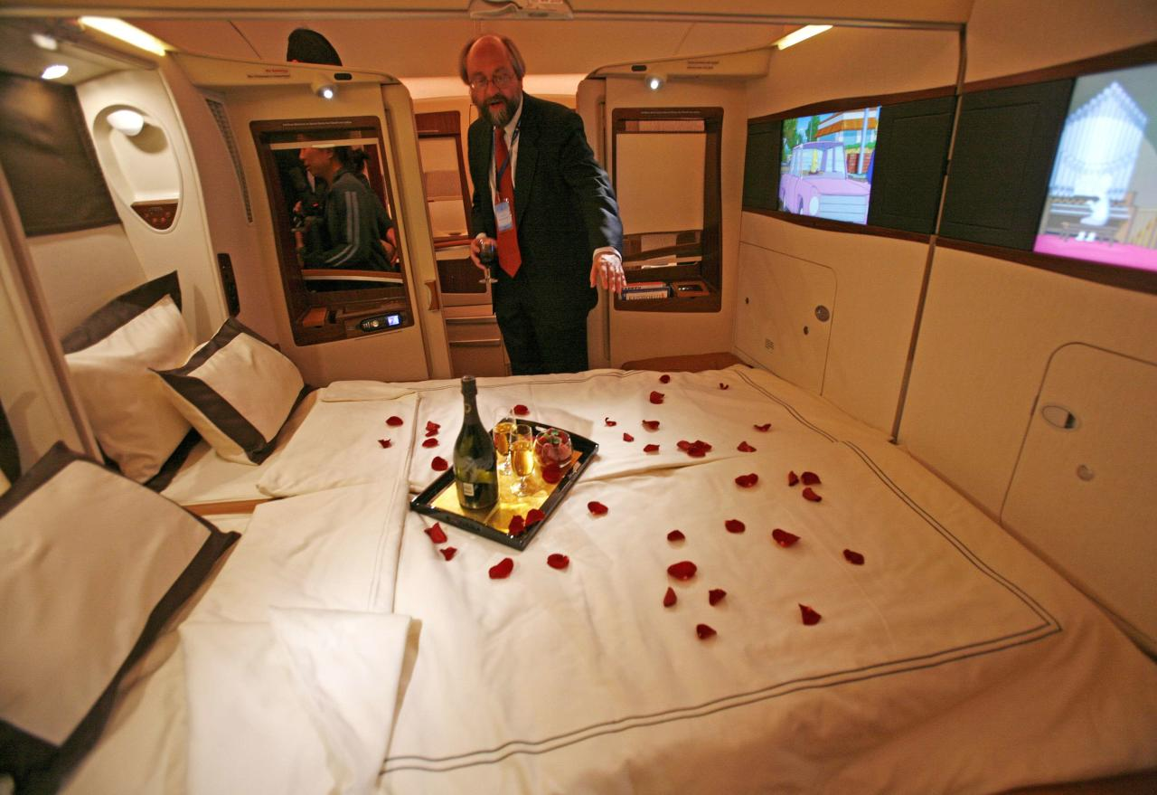 A journalist inspects a double bed first class suite during a media tour of the Airbus A380 superjumbo after it landed at Singapore's Changi Airport in this October 17, 2007 file photo. With limousine pick-ups and on-board chefs, Asia's premium airlines are investing hundreds of millions of dollars on luxury services in a bet on a rebound in business from the wealthy, even as low-cost carriers fly high with the booming middle class. To match story ASIA-AIRLINES/LUXURY  REUTERS/Vivek Prakash/Files (SINGAPORE - Tags: TRANSPORT BUSINESS SOCIETY)