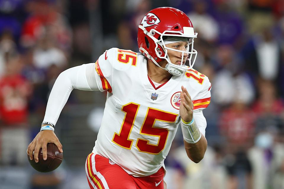 BALTIMORE, MARYLAND - SEPTEMBER 19: Patrick Mahomes #15 of the Kansas City Chiefs scrambles with the ball against the Baltimore Ravens during the second quarter at M&T Bank Stadium on September 19, 2021 in Baltimore, Maryland. (Photo by Todd Olszewski/Getty Images)
