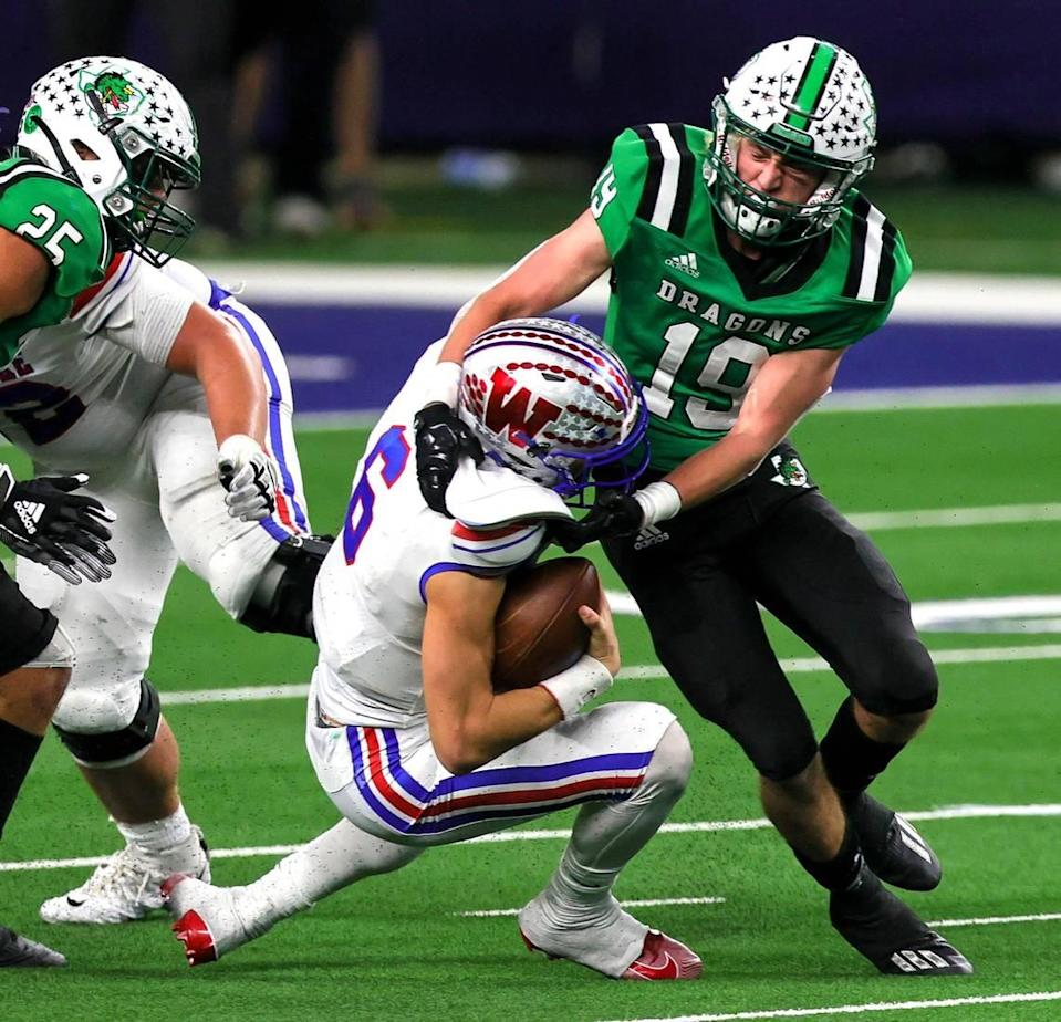 Southlake Carroll defensive back Logan Anderson (19) sacks Austin Westlake quarterback Cade Klubnik (6) during the second half of the 6A Division 1 High School State Championship football playoff game, January 16, 2021 played at AT&T Stadium in Arlington, Tx. (Steve Nurenberg Special to the Star-Telegram)