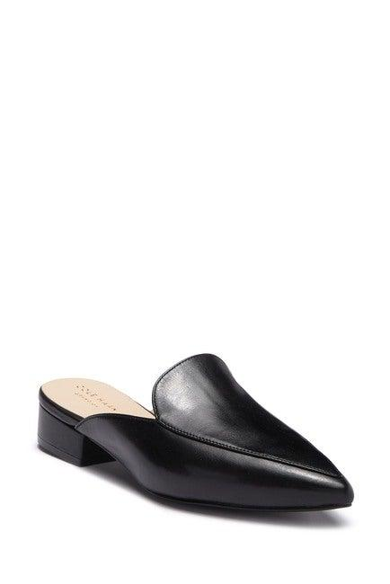 """<h3><a href=""""https://www.nordstromrack.com/shop/product/2740259/cole-haan-piper-mule"""" rel=""""nofollow noopener"""" target=""""_blank"""" data-ylk=""""slk:Cole Haan Piper Mule"""" class=""""link rapid-noclick-resp"""">Cole Haan Piper Mule</a></h3><br>""""A good low-heeled slide — like an open-back mule — is so easy to travel in. Makes on and off a breeze, and they're super comfortable for what can seem like an eternity walking through an airport terminal."""" <em>– Lori, travels a few times per year</em><br><br><strong>Cole Haan</strong> Piper Mule, $, available at <a href=""""https://www.nordstromrack.com/shop/product/2740259/cole-haan-piper-mule"""" rel=""""nofollow noopener"""" target=""""_blank"""" data-ylk=""""slk:Nordstrom Rack"""" class=""""link rapid-noclick-resp"""">Nordstrom Rack</a>"""