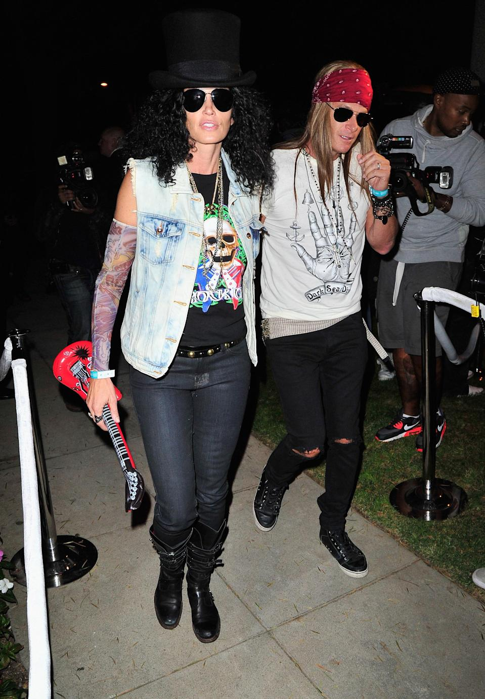 The famous couple looked incredible as one the Guns n' Roses musicians in 2013.
