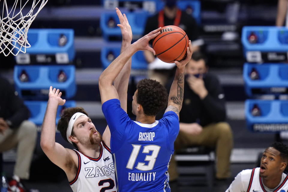 Creighton forward Christian Bishop (13) drives on Gonzaga forward Drew Timme (2) in the first half of a Sweet 16 game in the NCAA men's college basketball tournament at Hinkle Fieldhouse in Indianapolis, Sunday, March 28, 2021. (AP Photo/AJ Mast)