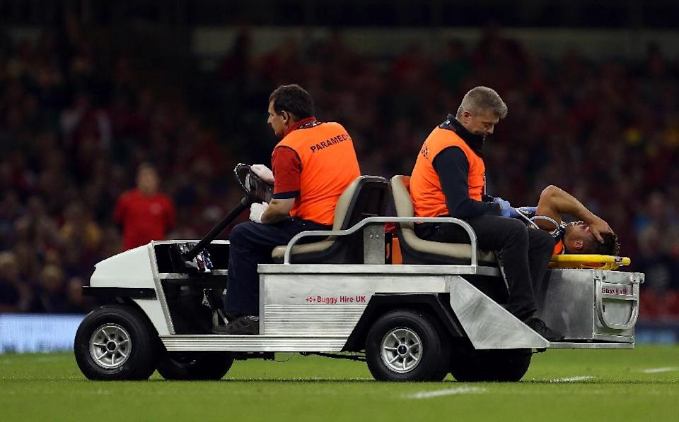 Wales scrum-half Rhys Webb is stretchered off with an injury during a World Cup warm-up match against Italy in Cardiff, on September 5, 2015 (AFP Photo/Geoff Caddick)