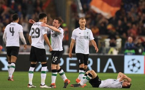 AS Roma versus Liverpool; James Milner of Liverpool falls to the floor in celebrations as Liverpool qualify for UEFA Champions League final - Credit: Getty Images