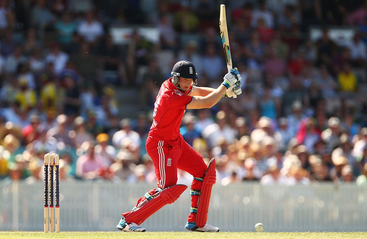 CANBERRA, AUSTRALIA - JANUARY 14:  Jos Buttler of England bats during the International tour match between the Prime Minister's XI and England at Manuka Oval on January 14, 2014 in Canberra, Australia.  (Photo by Mark Nolan/Getty Images)