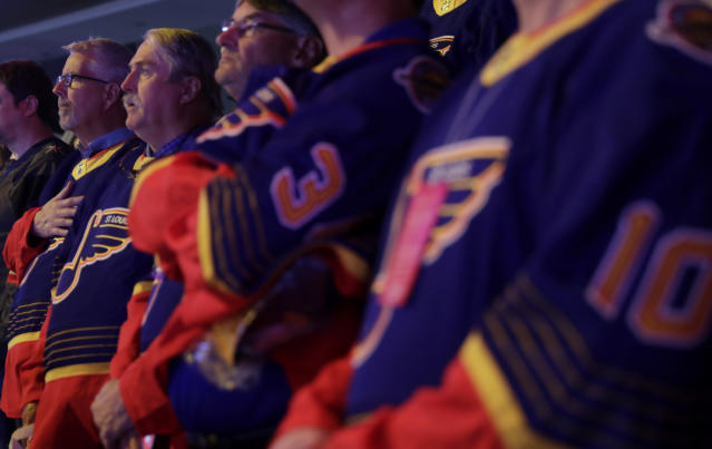 St. Louis Blues players' fathers stand for the national anthem prior to the Blues' NHL hockey game against the Vegas Golden Knights on Thursday, Feb. 13, 2020, in Las Vegas. (AP Photo/Isaac Brekken)