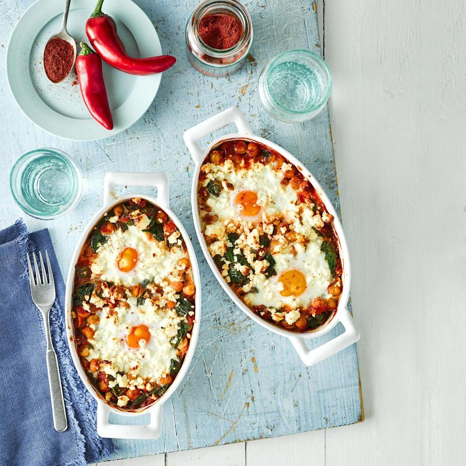 """<p>A recipe that's easily scalable to serve more or less. If you can find fresh cayenne chilli peppers, feel free to use instead of the red chilli. Makes a tasty brunch, too.</p><p><strong>Recipe: <a href=""""https://www.goodhousekeeping.com/uk/food/recipes/a35391784/spicy-tomato-feta-baked-eggs/"""" rel=""""nofollow noopener"""" target=""""_blank"""" data-ylk=""""slk:Spicy Tomato and Feta Baked Eggs"""" class=""""link rapid-noclick-resp"""">Spicy Tomato and Feta Baked Eggs</a></strong></p>"""