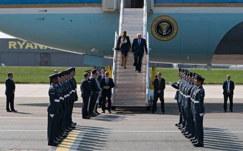 US President Donald J. Trump and First Lady Melania Trump leave Air Force One as they arrive at London Stansted Airport in Essex, UK, June 3, 2019. - Credit: WILL OLIVER/EPA-EFE/REX