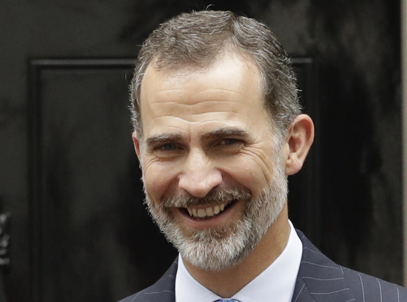 FILE - In this file photo dated Thursday, July 13, 2017, Spain's King Felipe arrives for a meeting with British Prime Minister Theresa May at 10 Downing Street in London. Spain's King Felipe VI has called for Catalonia's newly elected parliament to renounce any further designs for secession in the monarch's traditional televised address on Christmas Eve, Sunday Dec. 24, 2017.(AP Photo/Matt Dunham, FILE)