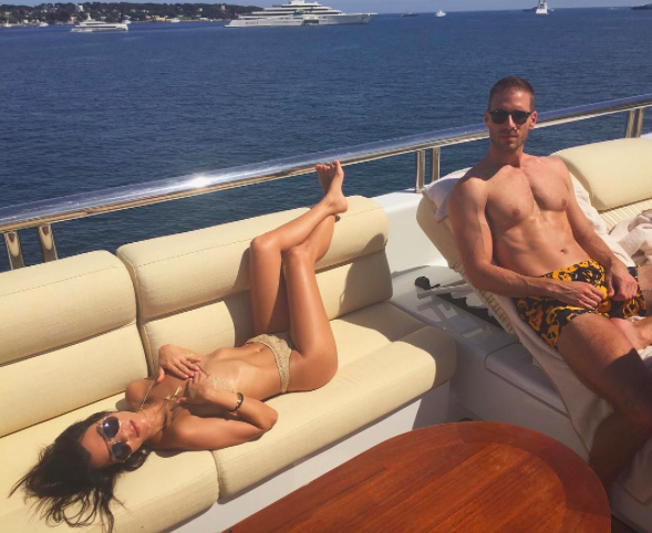 """<p>""""Cannes you feel it,"""" Kourtney Kardashian wrote beside a shot of herself sunning herself on the bench of a yacht, sans bikini top. Her hands artfully covered her breasts, and she finished the post with an ever-so-appropriate thermometer emoji. Her friend, sitting beside her, didn't look too impressed. (Photo: Kourtney Kardashian via Instagram)<span><br /></span> </p>"""