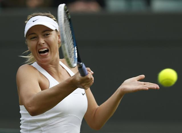 Maria Sharapova of Russia plays a return to Timea Bacsinszky of Switzerland during their women's singles match at the All England Lawn Tennis Championships in Wimbledon, London, Thursday, June 26, 2014. (AP Photo/Ben Curtis)