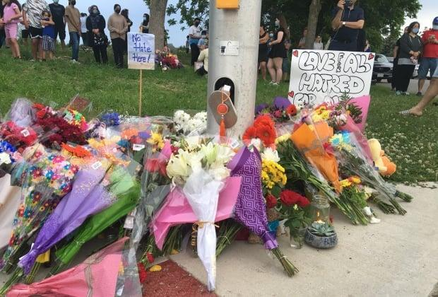 A memorial grew in the hours after a Muslim family was killed on Sunday evening in London, Ont. Police believe their killing was motivated by anti-Muslim hate.
