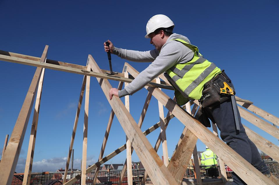 A builder working for Taylor Wimpey builds a roof on an estate in Aylesbury, Britain, February 7, 2017.  REUTERS/Eddie Keogh