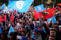 Albanian opposition Democratic Party supporters wave national and party flags
