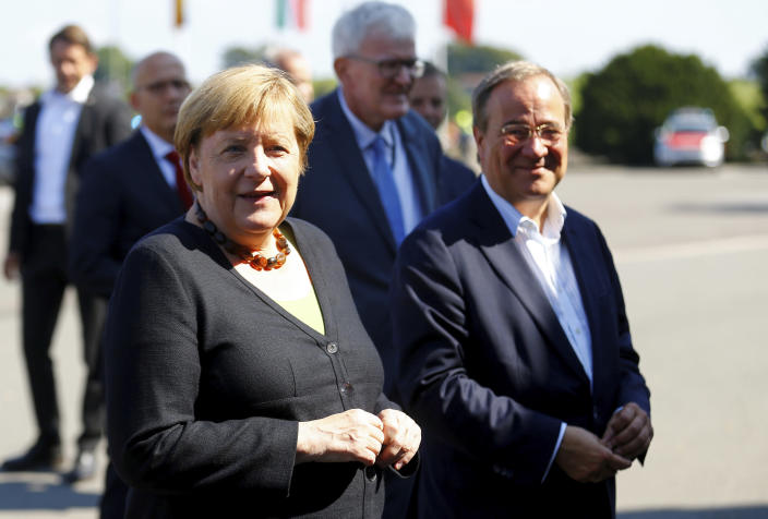 German Chancellor Angela Merkel and North Rhine-Westphalia's State Premier, chairman of the Christian Democratic Union party and candidate for Chancellery Armin Laschet, right, visit the fire station in Schalksmuehle, Germany, Sunday Sept. 5, 2021. (Thilo Schmuelgen/Pool via AP)