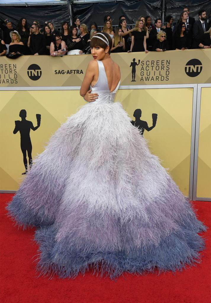 <p>The nominated <em>Orange is the New Black</em> actress stunned in an ombré lilac feather gown. (Photo: Getty Images) </p>
