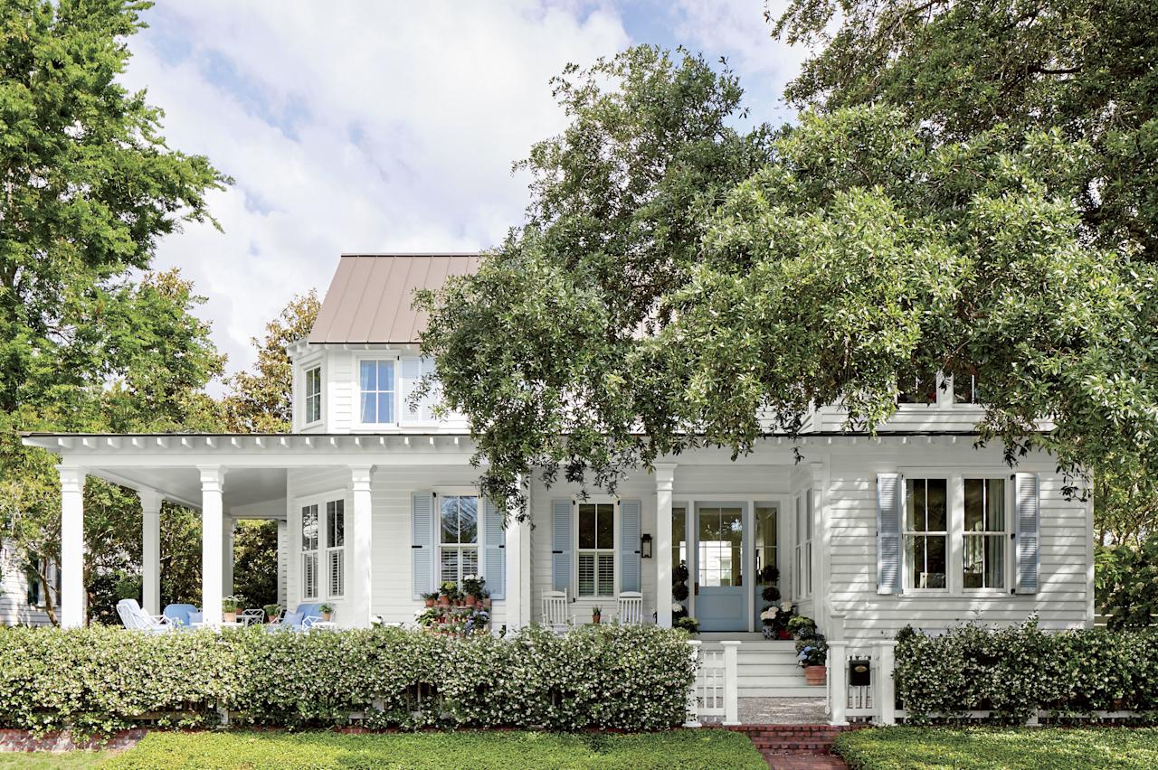 """<p>Equal parts quintessential Southern and modern-day millennial, this home (complete with a white picket fence) is one property that perfectly reflects its owner. Julia Engel may have 1.2 million Instagram followers (<a href=""""https://www.instagram.com/juliahengel/"""">@juliahengel</a>) and counting, but she considers herself more traditional than trendy. In fact, her lifestyle blog and budding fashion empire, <a href=""""https://galmeetsglam.com/welcome/"""">Gal Meets Glam</a>, is built upon her knack for reinventing classics with a contemporary spin—whether that's a floral-print dress topped with a cardigan or the laid-back sophistication of her Lowcountry cottage in the city's Old Village District.</p> <p>The crisp white paint and buzzy blue shutters (Benjamin Moore's <a href=""""https://www.benjaminmoore.com/en-us/color-overview/find-your-color/color/oc-117/simply-white?color=OC-117"""">Simply White</a> and <a href=""""https://www.benjaminmoore.com/en-us/color-overview/find-your-color/color/1641/blue-porcelain?color=1641"""">Blue Porcelain</a>) complete the photogenic cottage style.</p>"""