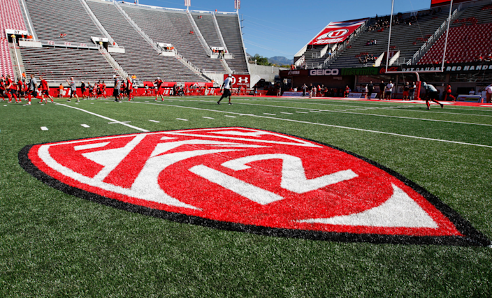 """The Pac-12 logo in Rice Eccles Stadium before a game between Utah and BYU. <span class=""""copyright"""">(George Frey / Getty Images)</span>"""