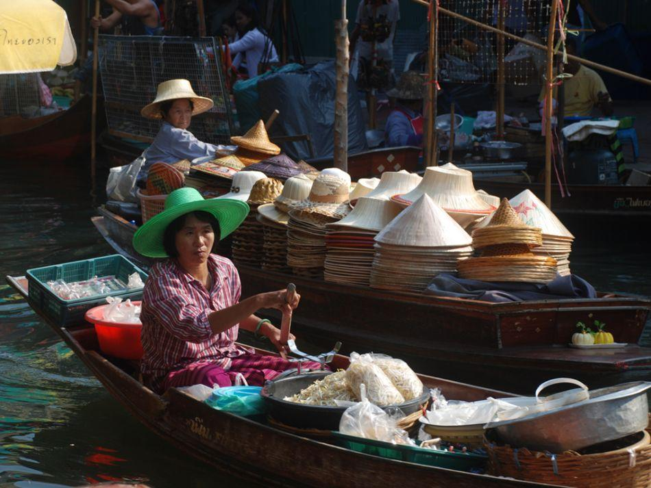 "A typical scene in the Floating Market at Damnoen Saduak in Thailand. <br><br><b>MITHUN BASAK</b> is a travel photographer. View more of his work <a target=""_blank"" href=""http://www.beautyaroundme.com"">at his website</a>"