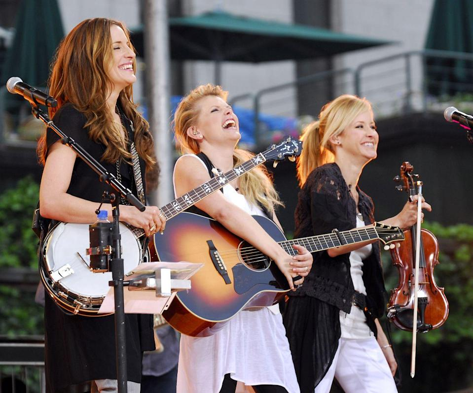 """<p>The <a href=""""https://www.democracynow.org/2007/2/15/shut_up_and_sing_dixie_chicks"""" rel=""""nofollow noopener"""" target=""""_blank"""" data-ylk=""""slk:Dixie Chicks caused controversy"""" class=""""link rapid-noclick-resp"""">Dixie Chicks caused controversy</a> in the early 2000s when vocalist Natalie Maines made a comment criticizing President George W. Bush's plan to invade Iraq. Their songs were quickly banned from many country music stations. In 2006, they released """"Not Ready to Make Nice"""" as a response to the radio bans and the numerous death threats they received as a result of the comment. </p>"""