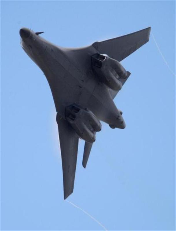 A Boeing B1-B bomber flies on the second day of the Farnborough International Airshow in south England