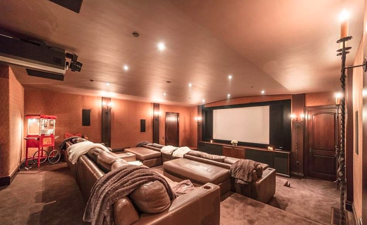 <p>TheSpanish-style mansion has its own private screening theatre room.</p>