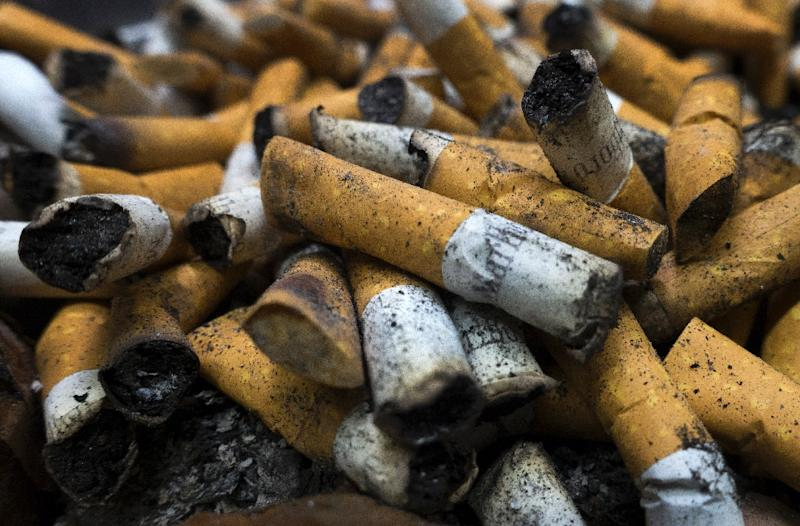 """Court-ordered tobacco company """"corrective statements"""" about the health dangers of smoking, which have begun appearing in newspapers, were hailed by the American Cancer Society (AFP Photo/PAUL J. RICHARDS)"""