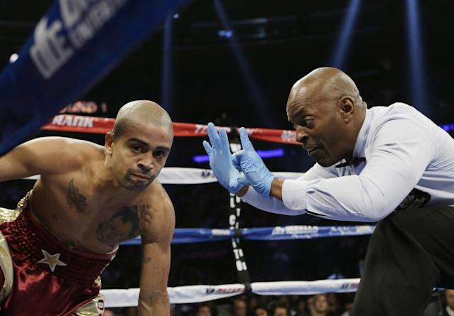 The referee counts after Wilfredo Vazquez, of Puerto Rico, after he was knocked down by Marvin Sonsona, of the Philippines, during the first round of a NABF Featherweight Title boxing match Saturday, June 7, 2014, in New York. Sonsona won the fight. (AP Photo/Frank Franklin II)