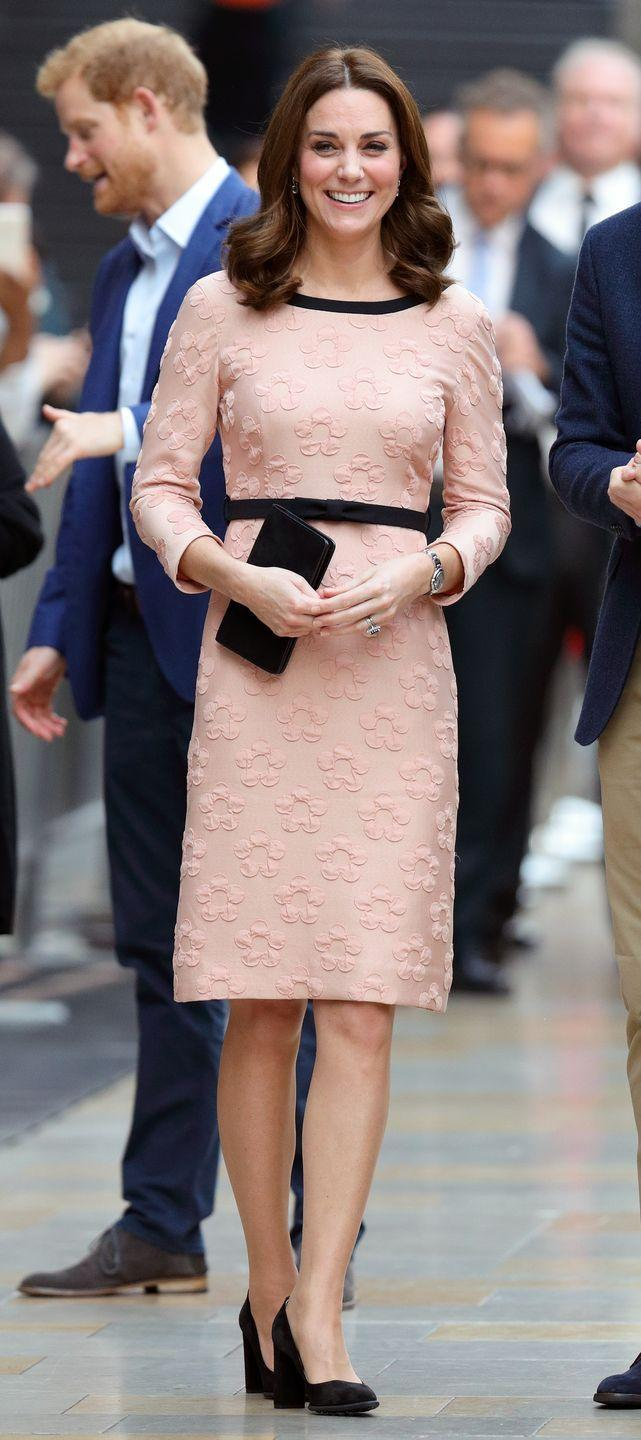 <p>For a Charities Forum Event at Paddington Station in 2017, Kate looked classically put-together in a pink dress with floral patterned texture and black accents. </p>