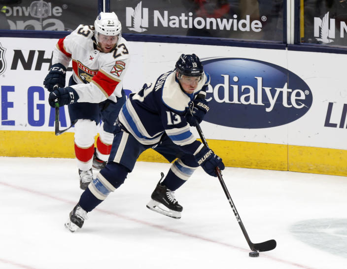 Columbus Blue Jackets forward Cam Atkinson, right, controls the puck in front of Florida Panthers forward Carter Verhaeghe during the first period of an NHL hockey game in Columbus, Ohio, Tuesday, Jan. 26, 2021. (AP Photo/Paul Vernon)