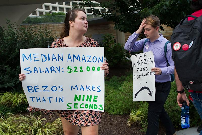 Mandatory Credit: Photo by Cliff Owen/AP/REX/Shutterstock (9881640b)Demonstrators protest against Amazon and Jeff Bezos, Amazon founder and CEO, outside of the hotel where the Economic Club of Washington is having their Milestone Celebration in Washington, .