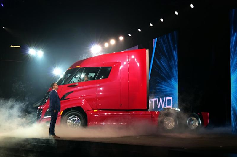 Nikola founder and CEO Trevor Milton and a prototype of the upcoming Nikola Two fuel cell big rig hauler.
