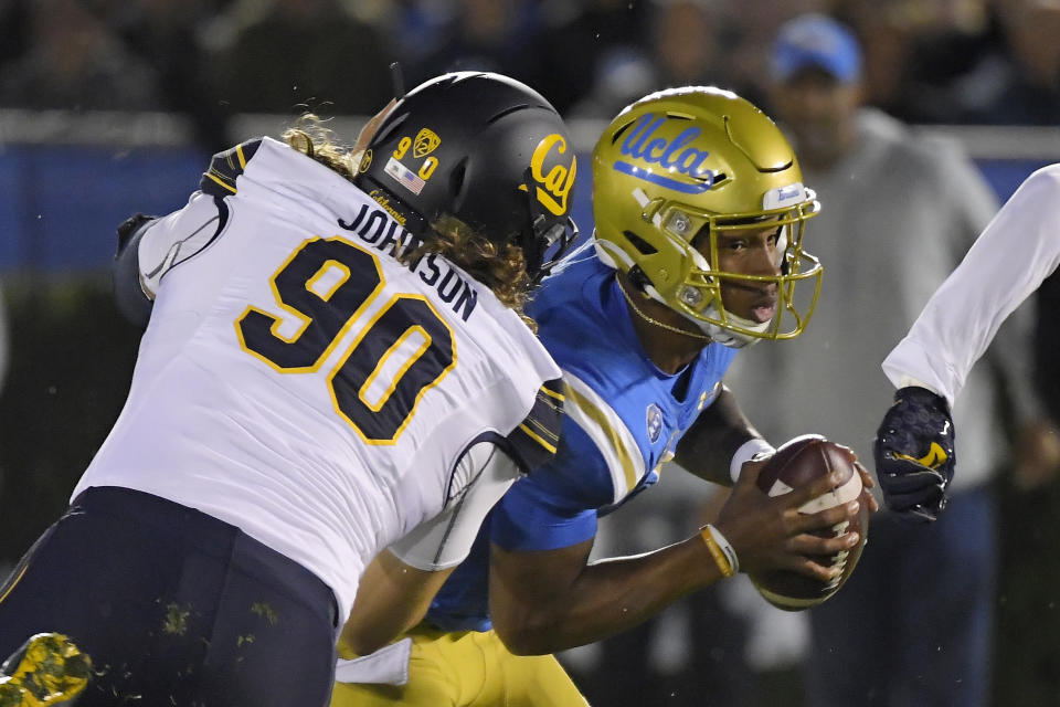 California nose tackle Brett Johnson, left, sacks UCLA quarterback Dorian Thompson-Robinson during the first half of an NCAA college football game Saturday, Nov. 30, 2019, in Pasadena, Calif. (AP Photo/Mark J. Terrill)