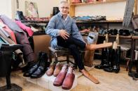 Romanian shoemaker Grigore Lup poses for a portrait while showcasing a pair of his long-nosed leather shoes, amid the outbreak of the coronavirus disease (COVID-19), in Cluj-Napoca