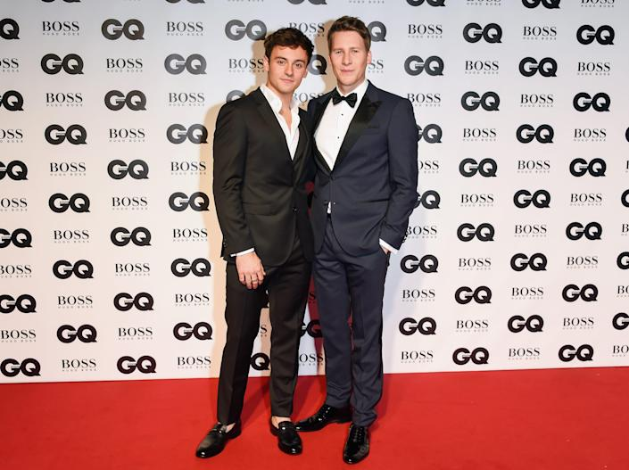 Tom Daley and Dustin Lance Black in 2018 dressed in tuxes on a red carpet