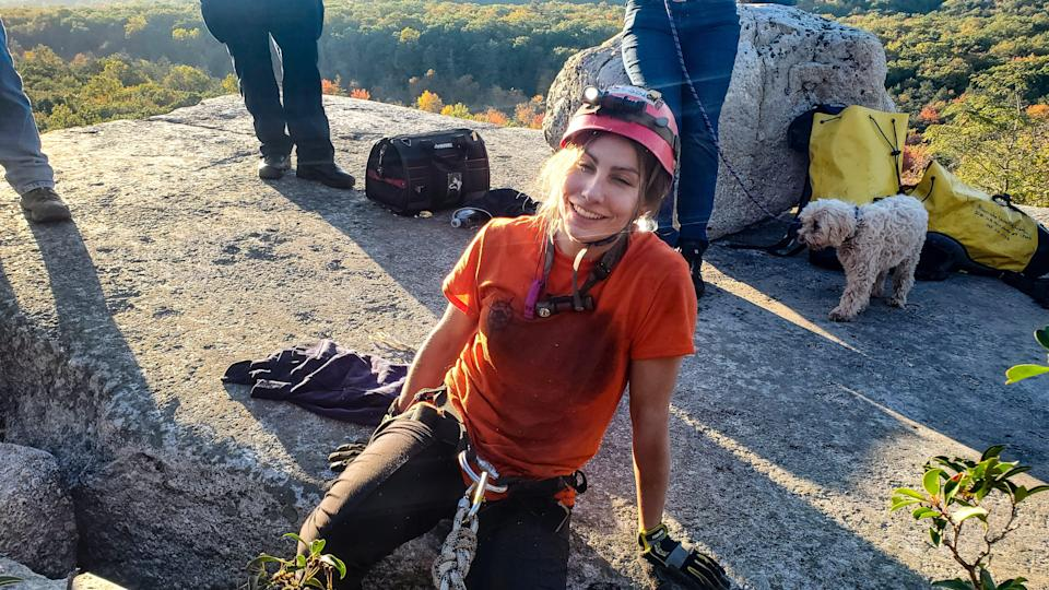 Jessica Van Ord, a rescuer with the New Jersey Initial Response Team, smiles after she was able to slide into a crevice to rescue a 12-year-old dog, Liza, near Gertrude's Nose Trail in Minnewaska State Park Preserve in Ulster County on Tuesday, Oct. 12, 2021.