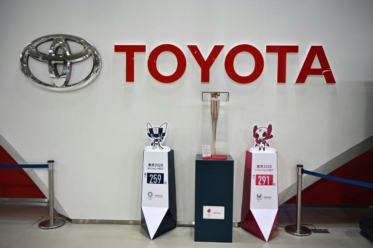 Toyota said it was revising up its sales and profit forecasts for the year as demand recovered qiucker than expected
