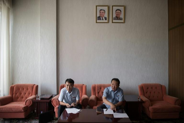 Han Chol-Su (R), vice director of the Wonsan Zone Development Corporation, and Ri Kyong Chol (L), section chief of Wonsan Zone Development Corporation, speak to AFP at the Koryo hotel in Pyongyang