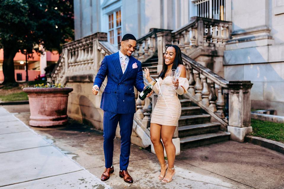 Couple celebrating after paying off debt