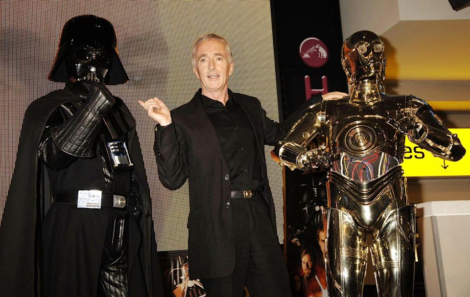 Anthony Daniels (centre, who plays C3-PO, right) with Darth Vader during a photocall to mark the launch of the new Star Wars DVD, 'Episode III: Revenge Of The Sith' and the Star Wars 'Battlefront II' video game, at the Oxford Street HMV, central London, Monday 31 October 2005. PRESS ASSOCIATION Photo. Photo credit should read: Yui Mok/PA