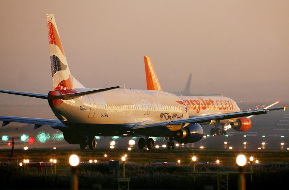 British Airways and EasyJet passenger planes prepare for an early morning take off at Gatwick Airport in West Sussex.