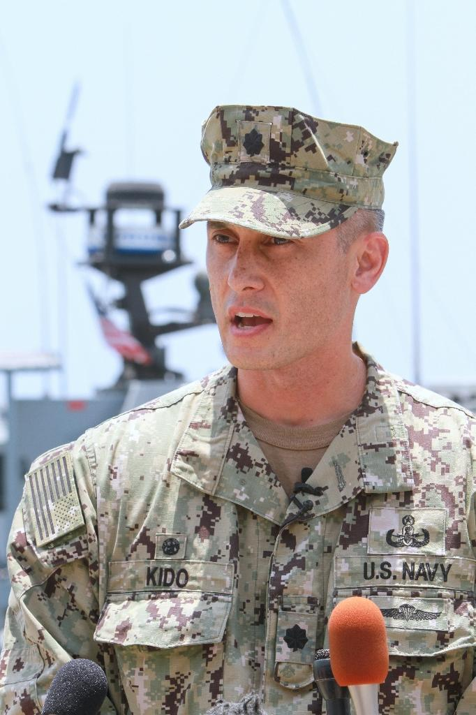 Commander Sean Kido of the US navy speaks during a press briefing at a UAE naval facility near the port of Fujairah on June 19, 2019 (AFP Photo/-)