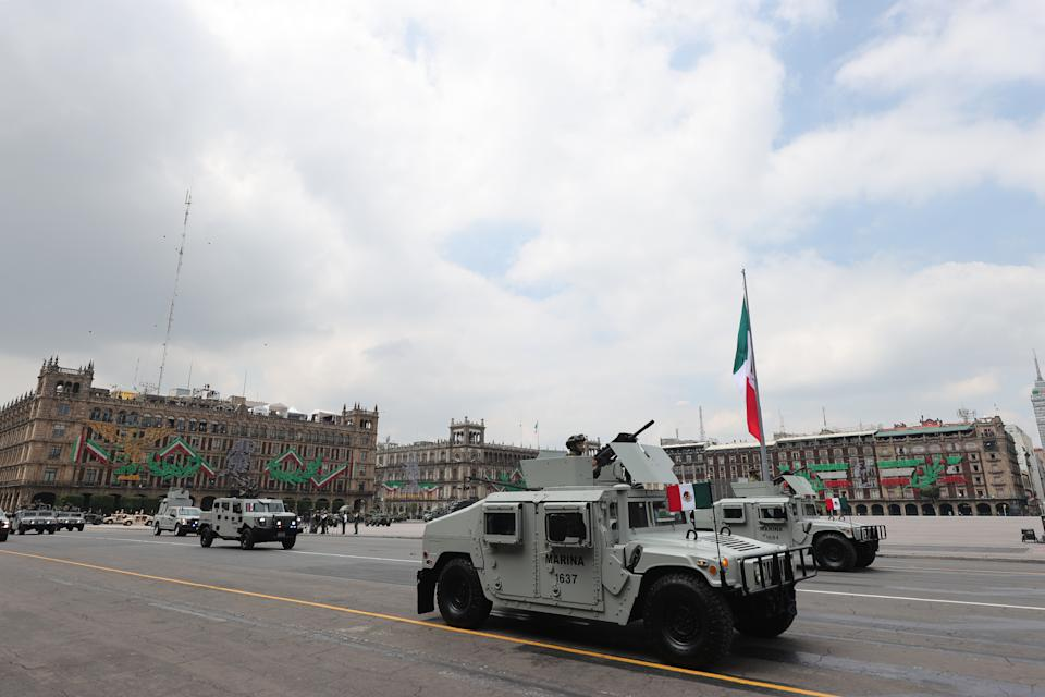 VARIOUS CITIES, MEXICO - SEPTEMBER 16: Marines vehicles march during the Independence Day military parade at Zocalo Square on September 16, 2020 in Various Cities, Mexico. This year El Zocalo remains closed for general public due to coronavirus restrictions. Every September 16 Mexico celebrates the beginning of the revolution uprising of 1810. (Photo by Hector Vivas/Getty Images)