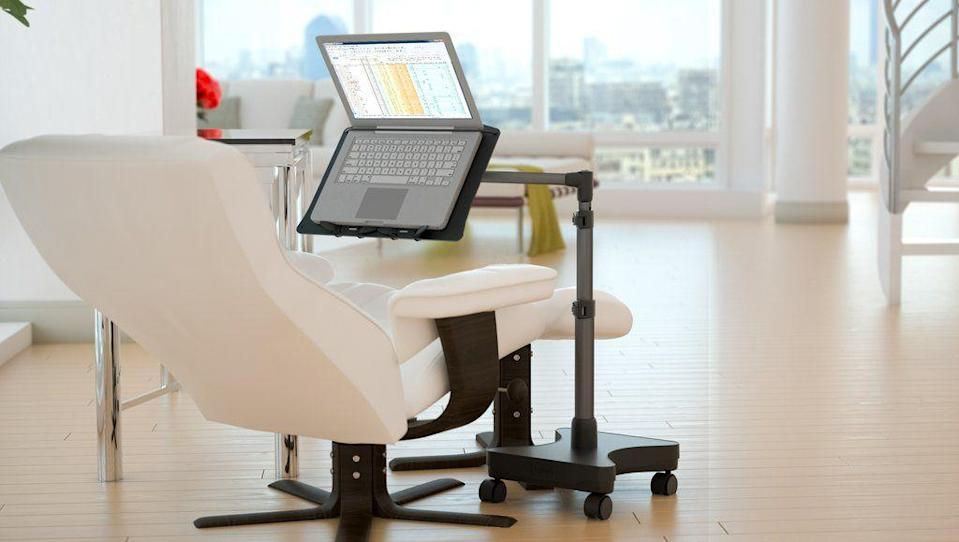 """<p><strong>Levo</strong></p><p>levostore.com</p><p><strong>$189.99</strong></p><p><a href=""""https://levostore.com/products/levo-rolling-laptop-workstation-stand"""" rel=""""nofollow noopener"""" target=""""_blank"""" data-ylk=""""slk:BUY NOW"""" class=""""link rapid-noclick-resp"""">BUY NOW</a></p><p>Having a portable workstation makes all of the difference when space is limited. This rolling workstation is ideal for laptops up to sixteen inches and is perfect for working while sitting on a chair, sofa, or bed. The stand was designed to minimize bouncing while typing as well as adjust from sitting to a standing position with ease.</p>"""