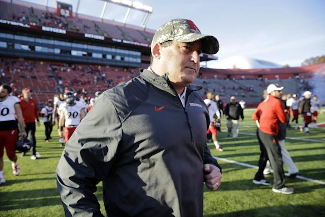 FILE - In t his Nov. 16, 2013, file photo, Rutgers defensive coordinator Dave Cohen walks off the field after an NCAA college football game against Cincinnati in Piscataway, N.J. A law firm's investigation has determined that Cohen, a former assistant football coach at Rutgers, did not bully a former player and there was no retaliation against the player. The report issued Tuesday, Jan. 28, 2014, also found the university responded appropriately. (AP Photo/Mel Evans, File)