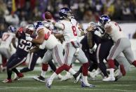 New York Giants quarterback Daniel Jones, center, throws a touchdown pass to Golden Tate in the first half of an NFL football game against the New England Patriots, Thursday, Oct. 10, 2019, in Foxborough, Mass. (AP Photo/Charles Krupa)