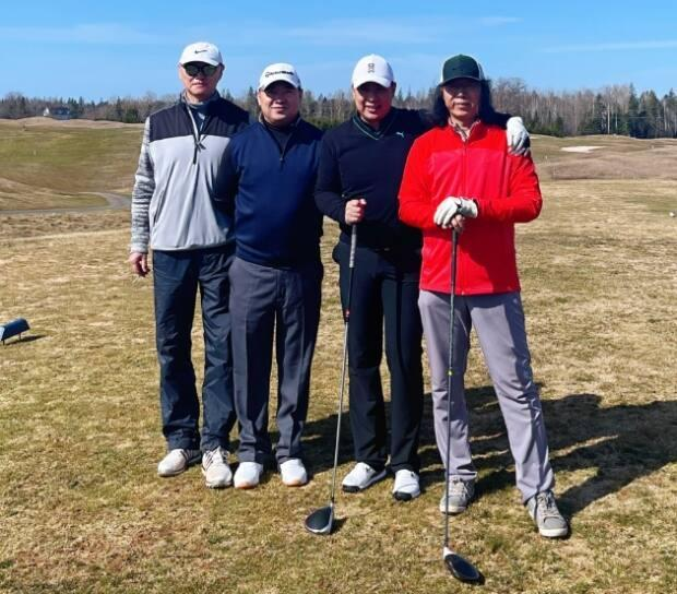 Frank Zhou, second from right, and his golfing buddies Qiang Wei, Mingli Wang and Paul Yin played their first round of the season at Avondale on Friday.